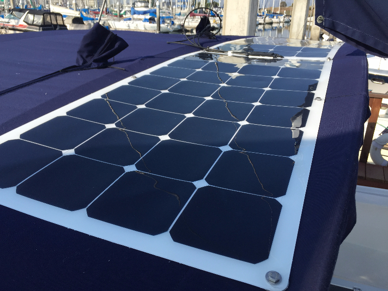 Two 110 Watt Semi-flexible Marine Solar Panels Installed Using the Bolt on kit Method to canvas on boat