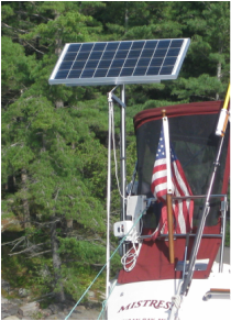 rigid marine solar panel solar system kit on sailboat with panel mounted top of pole on sailboat