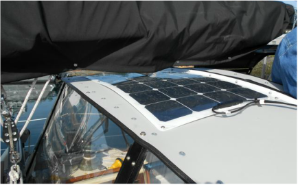 110 Watt Semi-flexible Marine Solar Panel Attached to a Hard Top Dodger Using 3M VHB Tape and Fasteners on a Sailboat