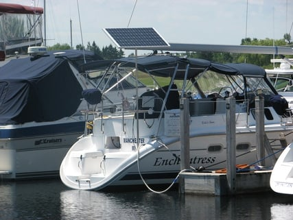 130 watt rigid marine solar panel mounted with top of pole system on Hunter 41 foot sailboat