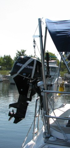 outboard motro lift crane on sailboat mounted to stern rail