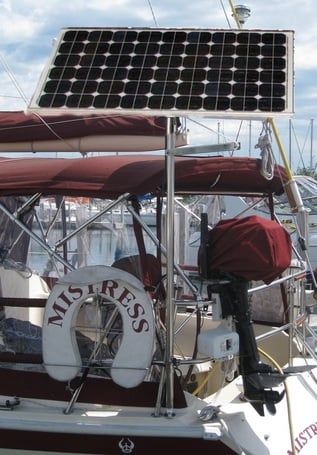 130 watt rigid marine solar panel mounted to top of pole on sailboat 38 foot  Ericson
