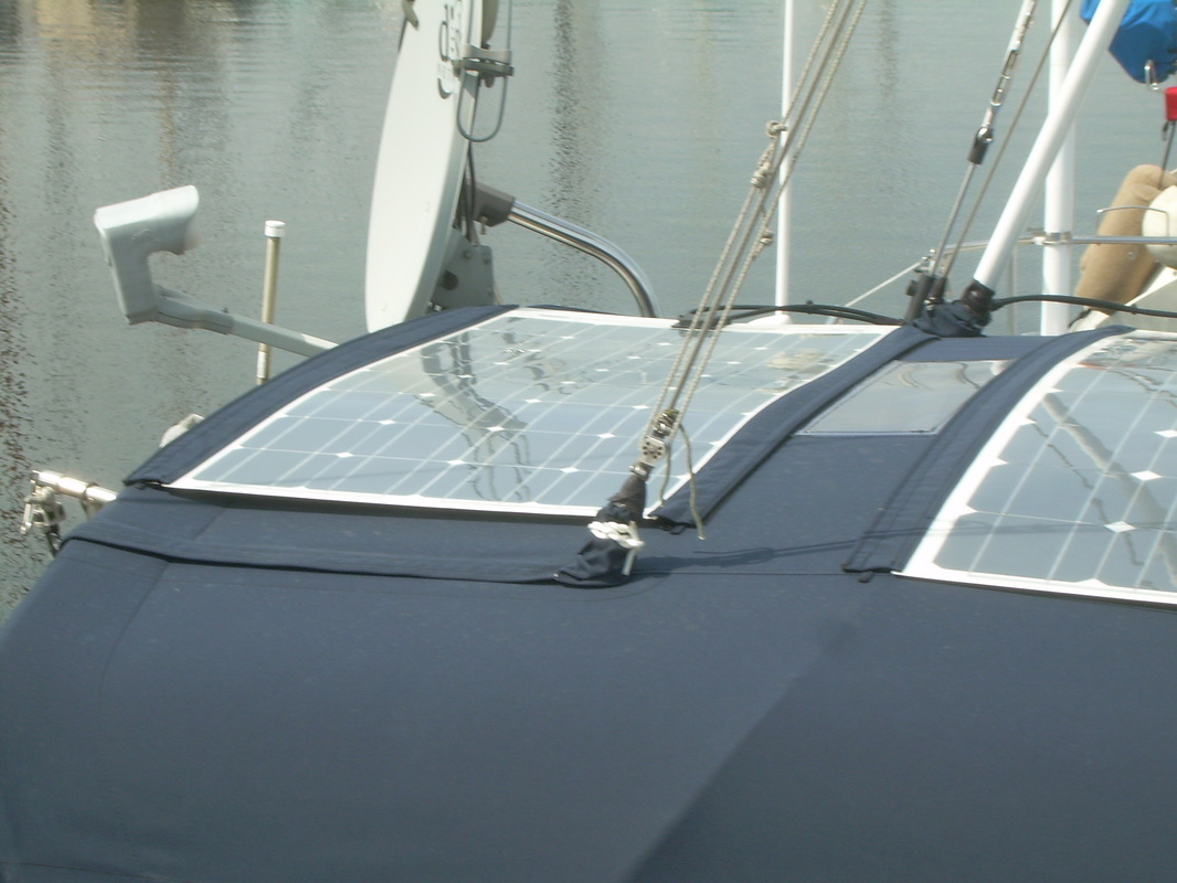 2 flexible marine solar panels mounted on dodged canvas on boat