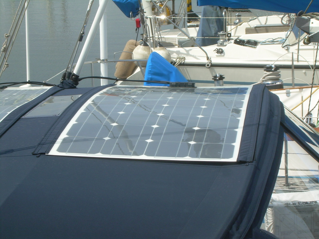 100 Watt Flexible Marine Solar Panels Attached to the Bimini with Zippers on Boat
