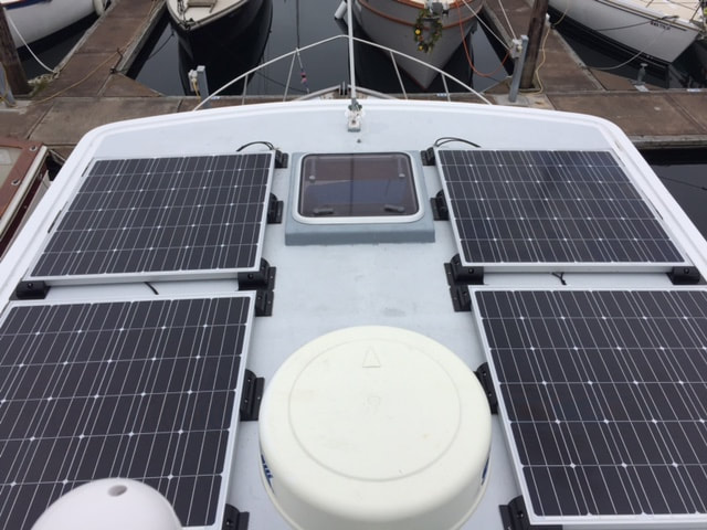 Four 160 Watt Marine Solar Panels on a Tayana 42 Trawler using EP Tracer BN MPPT Controllers on a trawler boat