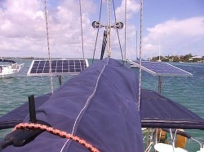 two rigid marine solar panels mounted on sailboar with top of pole mounting system
