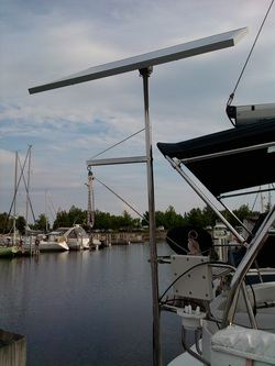 hunter sailboat with rigid marine solar panel mounted with top of pole system