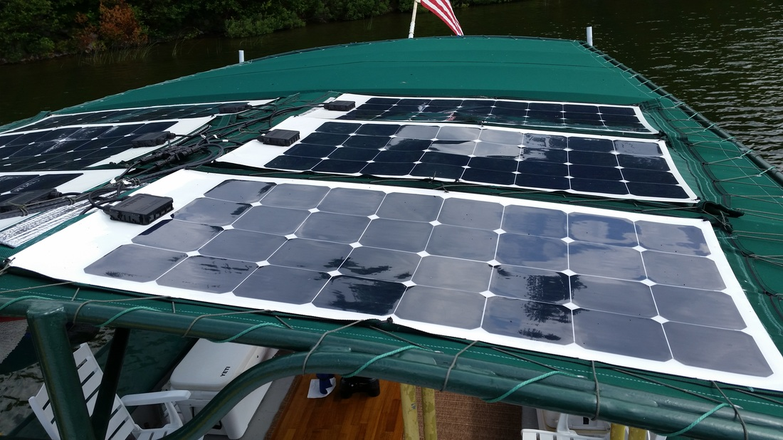 Updated Configuration of Six 100 Watt Flexible Marine Solar Panels on boat