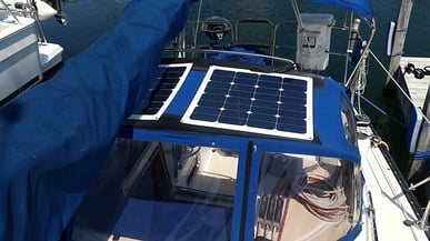 Two 50 Watt Semi-flexible Solar Panels Wired in Parallel on dodger on boat