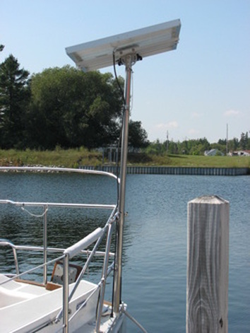 rigid marine solar panel mounted with adjustable top of pole mounting kit on boat