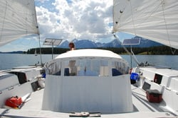 two rigid marine solar panels mounted top of pole on catamaran sailboat