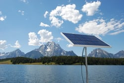 rigid marine solar panel mounted top of pole on sailboat with Teton mountains