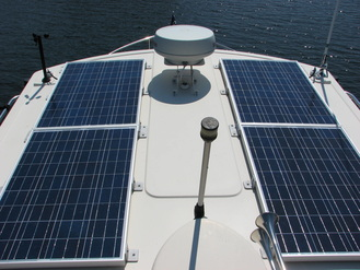 Four 100 Watt rigid marine Solar Panels on a Nordic Tugboat 32
