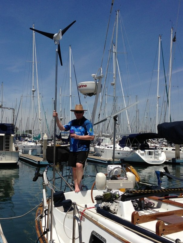 wind generator mounted on sailboat using CMP pole system and rigid marine panel mounted top or pole