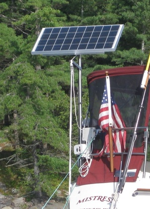marine solar setup on sailboat with top of pole mounting system