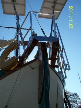 2 rigid marine solar panels mounted top of pole systems on sailboat