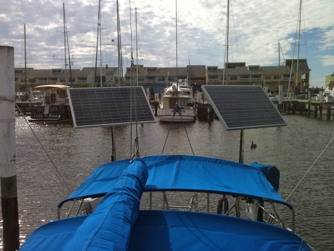 2 top of pole mounted marine rigid solar panels  on sailboat