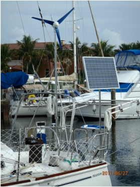 CMP 90 watt solar panel mounted top of pole and wind generator mounted top of pole on a sailboat