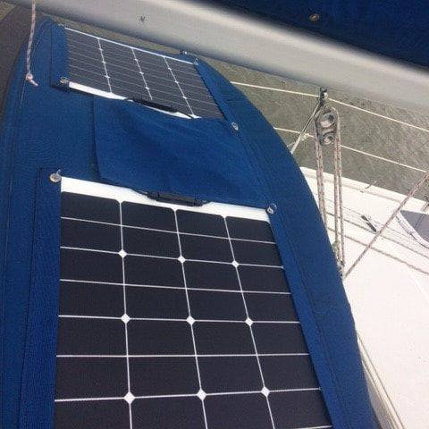 2 flexible marine solar panels mounted on a sailboat dodger