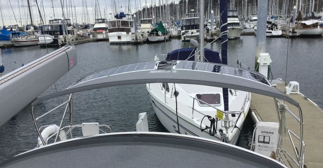 Two 110 watt semi-flexible marine solar panels with SunPower cells - Beneteau 50 sailboat Attached with Bolt-on mount Kit