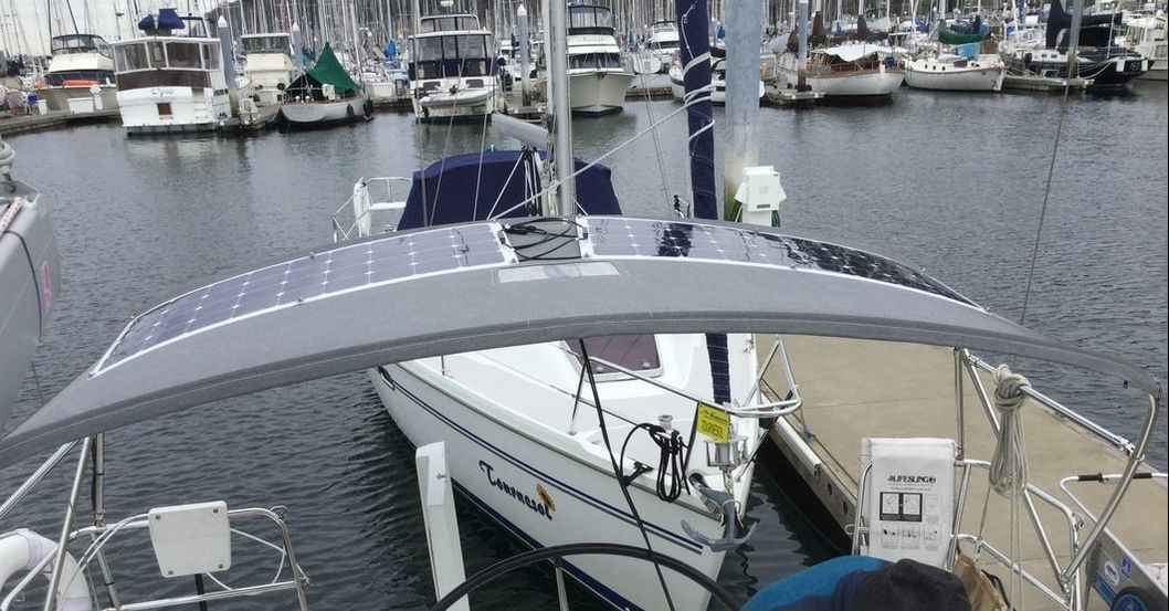 Two 110 watt semi-flexible marine solar panels with SunPower cells - Beneteau 50 sailboat on bimini with mount kit