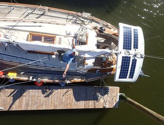 Four Flexible Solar Panels Managed by Two Controllers on sailboat, aerial view of boat