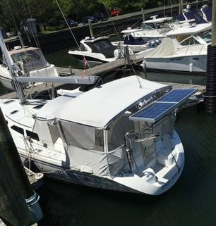Two 100 Watt Polycrystalline Rigid Marine Solar Panels mounted on a Catalina 42 sailboat