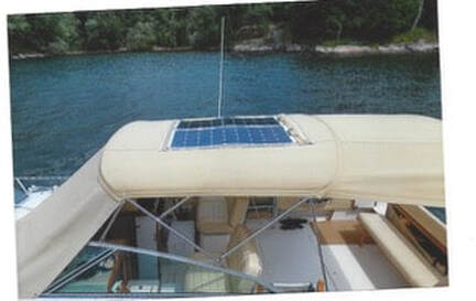 120 watt flexible marine solar panels mounted on canvas bimini top on boat