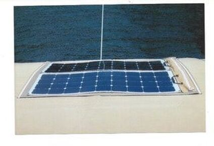 two 120 watt flexible marine solar panels mounted on bimini using solar panel mounting kit on boat