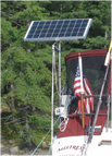 sailboat with top of pole mount rigid marine solar panel