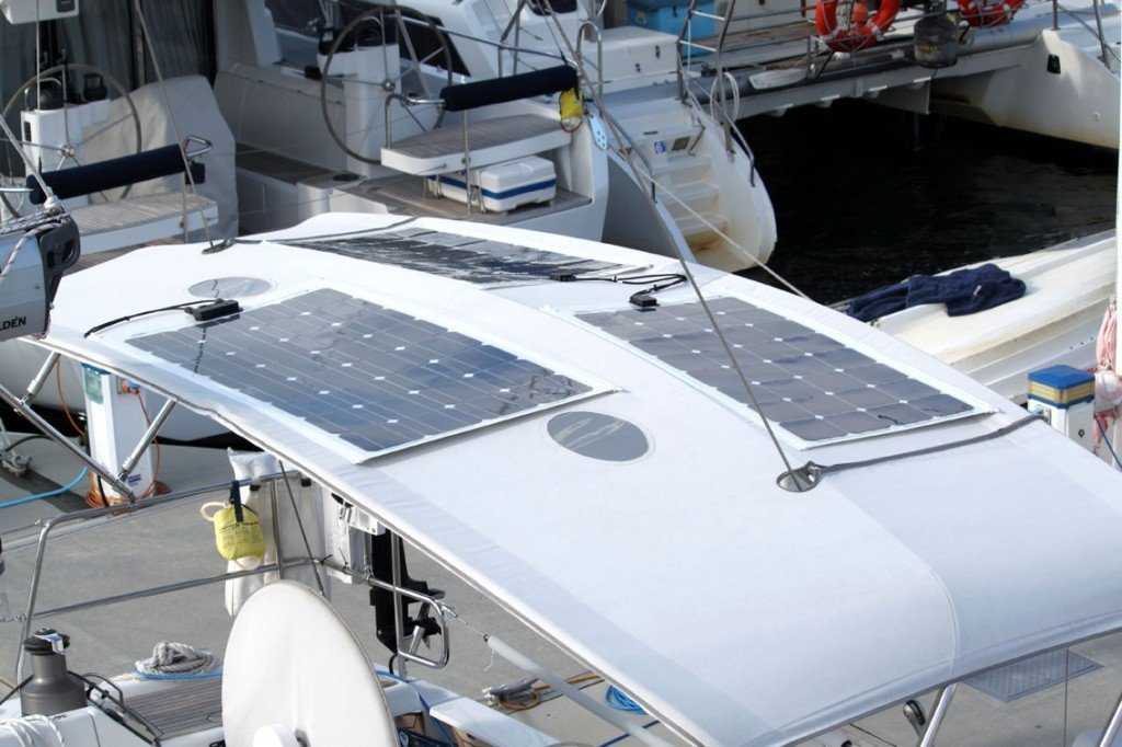 Three 100 Watt Semi-flexible Marine Solar Panels Attached to bimini with Zippers on boat