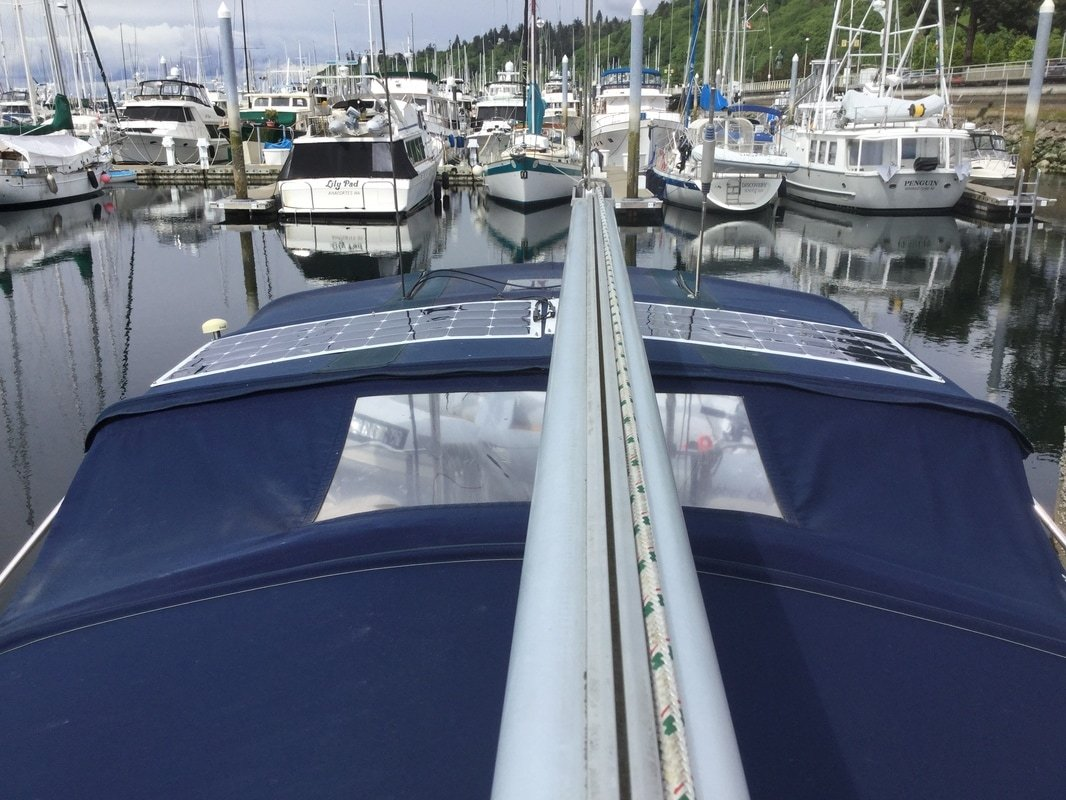 two 110 watt flexible marine solar panels mounted via bolting solar mount kit to bimini canvas on sailboat