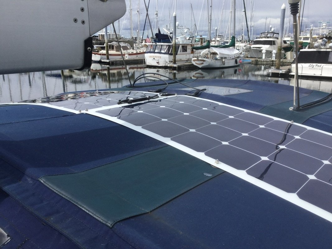 2 110 watt flexible marine solar panels with bolt-on solar panel mounting kit to bimini canvas on boat