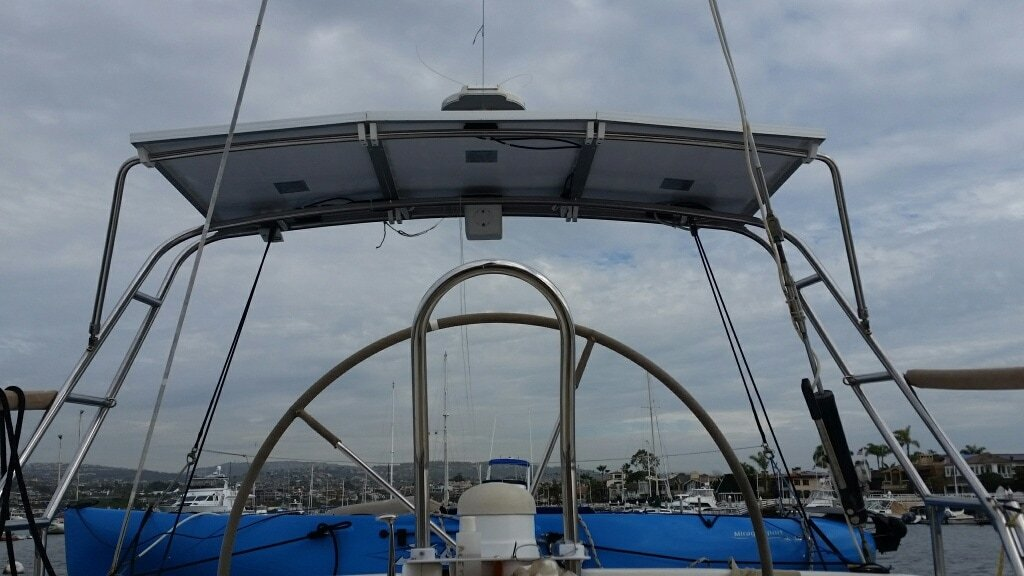 Three 120 watt rigid marine solar panels with SunPower cells on boat